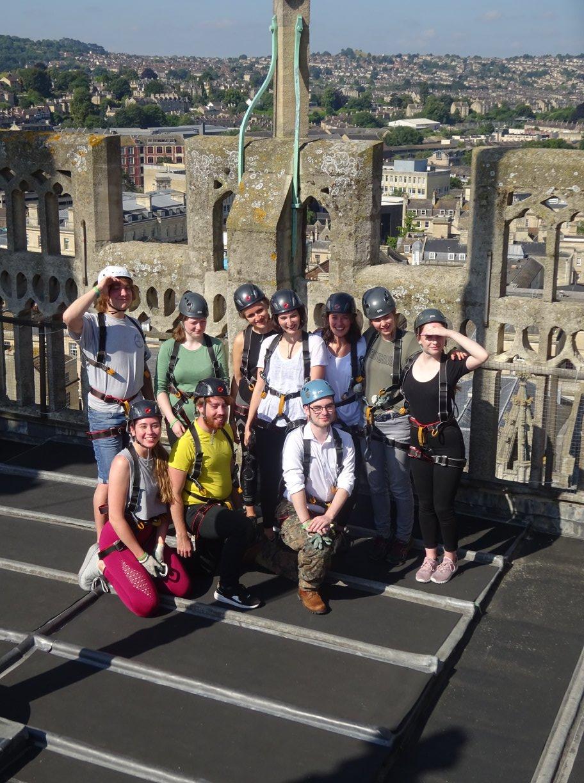 Abseil group on top of Bath Abbey